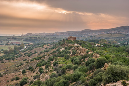agrigento: Sunset in Valley of temples in Agrigento in Sicily with clouds and night illumination.