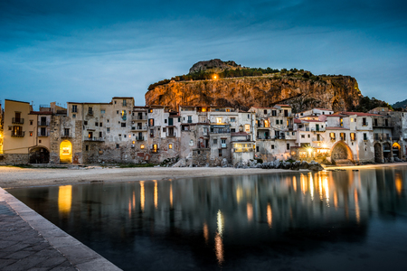 townscape: View on habour and old houses in Cefalu at night, Sicily. Beautiful townscape of old italian town. Travel photography. Stock Photo