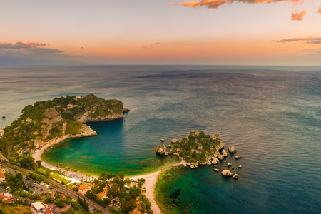 Beautiful landscape of Taormina, Italy. Sicilian seascape with beach and island Isola Bella. Travel photography. Imagens