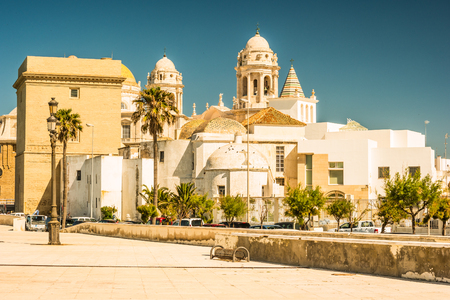 Beautiful view of Cadiz with cathedral and Iglesia Santa Cruz. Bright travel picture of sunny Andalusia. Stock Photo