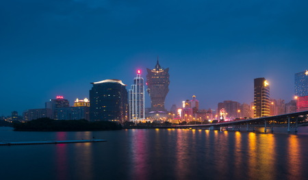 Skyline of Macau city at Nam Van Lake, China. The city maintains the worlds highest gambling revenue with over 20 million tourists annually.