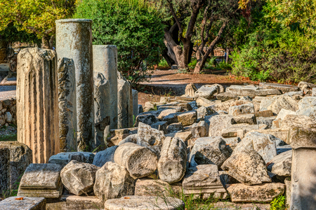 classical greek: Ancient agora, Athens, Greece. Beautiful landscape photography at dawn with ruins of classical greek architecture.