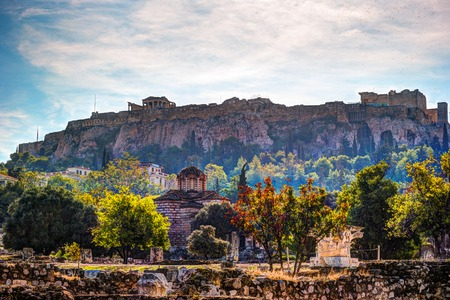 classical greek: View on Acropolis from ancient agora, Athens, Greece. Beautiful landscape photography at dawn with ruins of classical greek architecture. Stock Photo