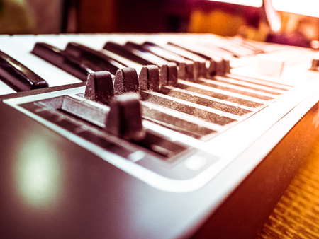 bpm: Keyboard of a synthesizer with sliders. Closeup of musical equipment .