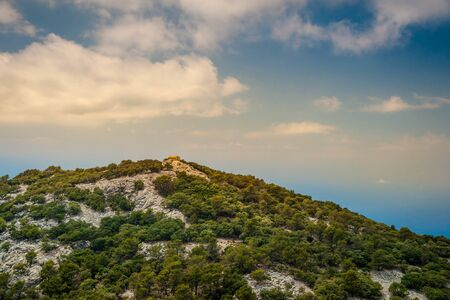 palma: Beautiful landscape with a little house in rocky mountains on the western part of Mallorca island, Spain. Tramuntana mountains with forest. Tourist trekking destination in Spain. Travel timelapse of a landmark.