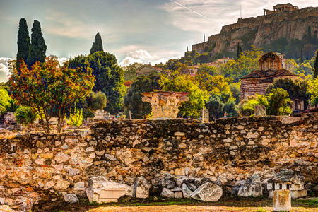 View on Acropolis from ancient agora, Athens, Greece. Beautiful landscape photography at dawn with ruins of classical greek architecture. Stock Photo