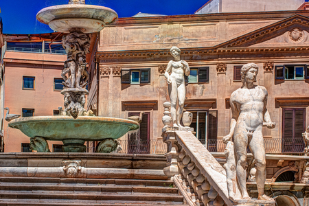 Beautiful sculpture of the famous fountain of shame on baroque Piazza Pretoria, Palermo, Sicily, Italy