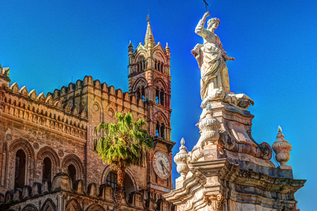 Sculpture in front of Palermo Cathedral church against blue sky, Sicily, Italy Stock Photo