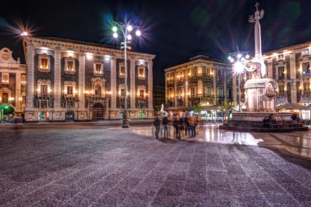 Night view of the Piazza del Duomo with the statue of the Elephant and the cathedral of Santa Agatha in Catania, Sicily, Italy.