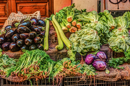 Fresh vegetables at a market in Palermo, Sicily. Onion, artichoke and eggplant.