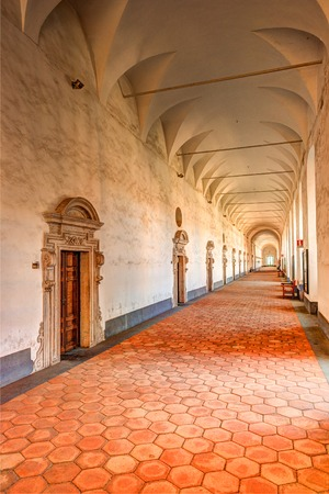 Image of the cloister arches inside a monastery. Architectural background. Stock Photo