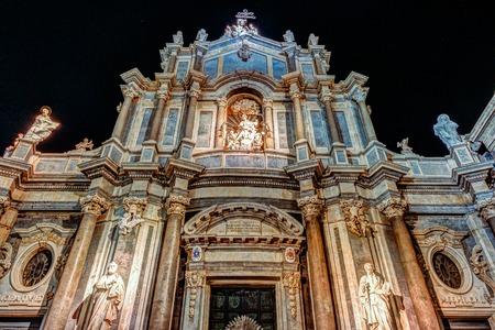 Facade of Cathedral of Santa Agatha at night, Catania duomo in Catania in Sicily, Italy.