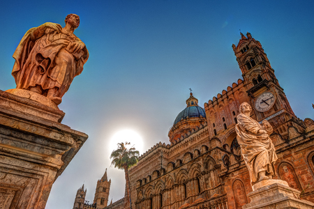 Sculpture in front of Palermo Cathedral church against sun, Sicily, Italy