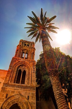 belltower: Belltower of church Martorana with palm trees, Palermo. Sicily. Beautiful architecture of the historical district. Stock Photo