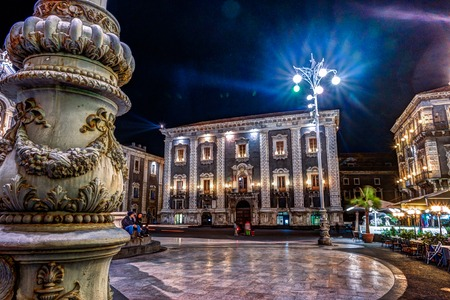 Piazza Duomo or Cathedral Square with Town Hall building in Catania, Renaissance architecture in Sicily, Italy.