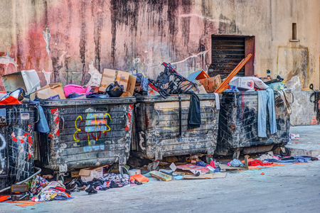 disposed: bin being full with garbage in a city. Stock Photo