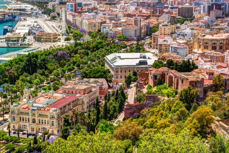 City Council Building in Malaga. Aerial view of Malaga taken from Gibralfaro castle including port of Malaga, Alcazaba castle and the Cathedral, Andalucia, Spain. Stock Photo