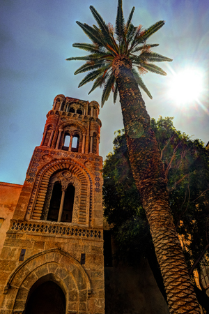 Belltower of church Martorana with palm trees, Palermo. Sicily. Beautiful architecture of the historical district. Stock Photo