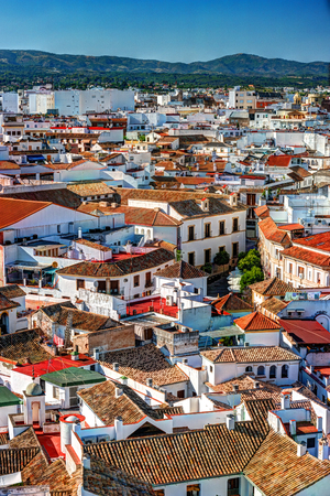 traditiional: Aerial view of Cordoba city in Spain. Ciityscape with old architectue and traditiional red roofs. Stock Photo