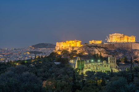 Parthenon and Herodium construction in Acropolis Hill in Athens, Greece shot in blue hour Stock Photo
