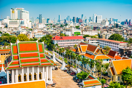 Aerial view of Bangkok monastery and modern office buildings