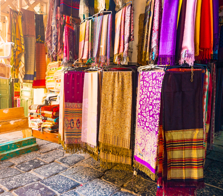 A variety of coloured cloths and silks from Northern Africa