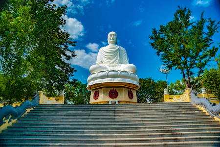 Statue of the Buddha against the blue sky.