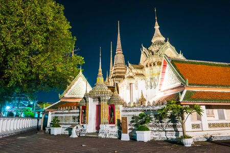 The beautifully decorated pagodas of Wat Pho temple at night. Stock Photo