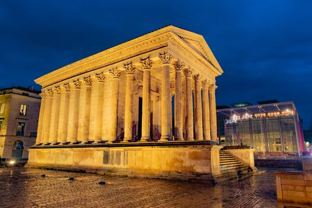 Maison Carree, ancient Roman temple in night lights, Nimes, France