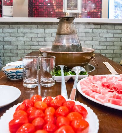 A traditional Chinese hotpot with meat and condiments. Food photography Reklamní fotografie