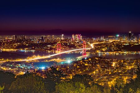 Istanbul Bosphorus Bridge at sunset. Night view from Camlica Hill. Istanbul, Turkey.