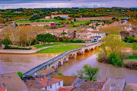 Panoramic aerial view at the Old Bridge over Orb river with Cathedral of Saint Nazaire in Beziers