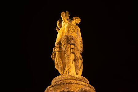 View on the statue of Three Graces at night with dark background in Montpellier city in France