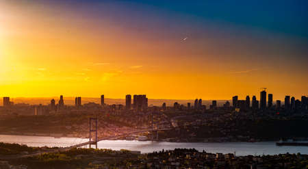 Cityscape of Istanbul with Bosphorus, skyscrapers, and 15th July Martyrs Bridge Bosphorus Bridge from Camlica hill at sunset Istanbul, Turkey Reklamní fotografie