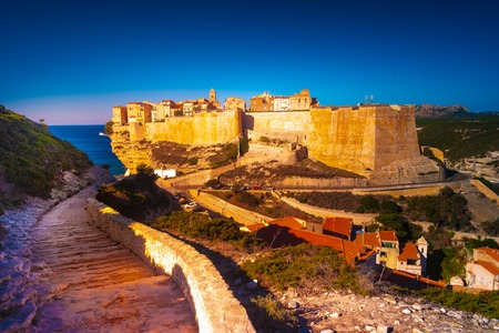 View of Bonifacio old town built on top of cliff rocks, Corsica island, France. Beautiful sunset landscape with old town Bonifacio.