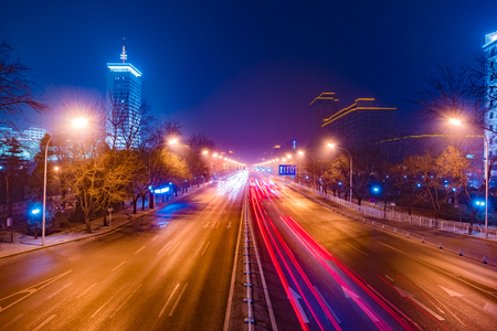 Modern city traffic at night, China, Beijing. Transportation background. Фото со стока