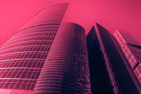 modern office buildings. Vintage looking image with washed out colors and red color cast