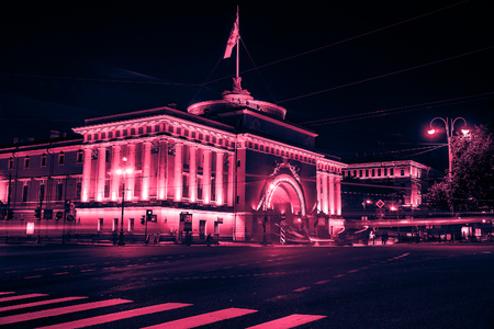 Beautiful night view of Admirality in Saint Petersburg. Vintage looking image with washed out colors and red color cast Imagens