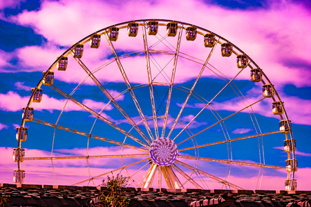 The Ferris wheel in the promenade of the Old Port in the city center of Marseilles, France. Colorful background image. Stock Photo