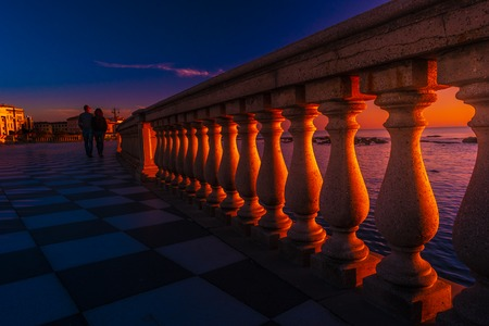 Abstract patterns in singular terrace Mascagni in Livorno, Italy. Balustrade against stunning sunset with long shadows. Banco de Imagens