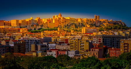 Sunset on Cagliari, panorama of the old city center with the Harbour in background, Sardinia Island, Italy