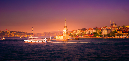 Maiden Tower with a boat and the Old City Silhouette in Istanbul Turkey. Beautiful travel destination in Istanbul.