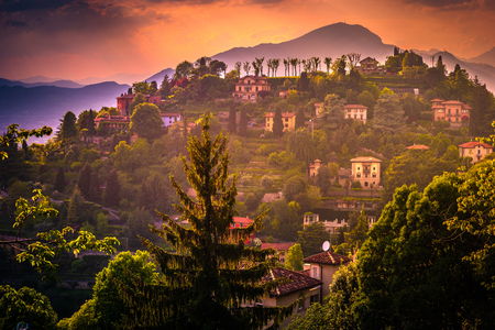 Panoramic view of Alps mountains in Lombardia from the castle walls of Bergamo old town, Italy