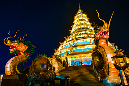 Beautiful dragon sculpture at night with dark sky background, Wat Huay Pla Kang, Chiang Rai, northern of Thailand. Reklamní fotografie