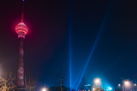 The Central Radio and Television Tower at night with colorful illumination, Beijing, China.