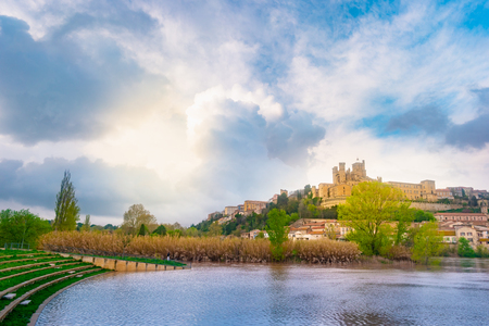 Panoramic view at the Old Bridge over Orb river with Cathedral of Saint Nazaire in Beziers Reklamní fotografie