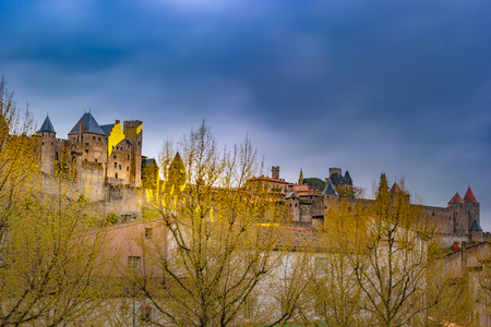 Night view over illuminated fortification of Carcassonne, France. Famous medieval city with beautiful night illumination. Reklamní fotografie