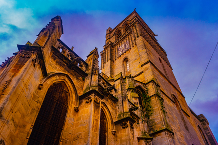 Beziers, Languedoc-Roussillon, France. The medieval cathedral in gothic style against cloudy sky at sunset Reklamní fotografie