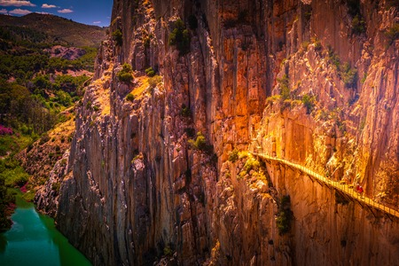 Caminito del Rey. Road to the old beautiful and a very narrow bridge between two steep mountains over the canyon with mountain river at the bottom. Andalusia, Spain.