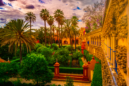 Beautiful amazing gardens in Reales Alcazares in Seville - residence developed from a former Moorish Palace in Andalusia, Spain